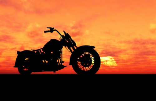 silhouette of a motorcycle at sundown