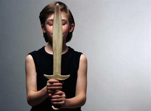 Boy holding a plastic sword