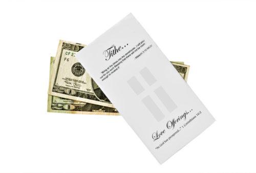 tithe envelope and two U.S. twenty dollar bills