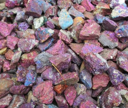 drab and rigid reddish brown gemstones before they are polished of their rough edges and made into gemstones