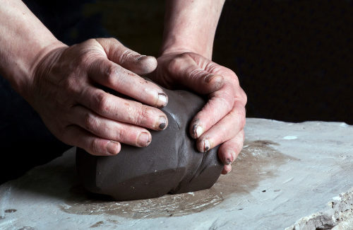 Hand molding potters clay