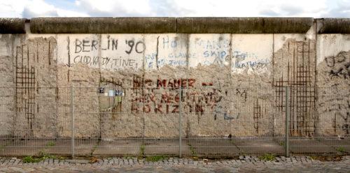 A broken down wall with graffiti