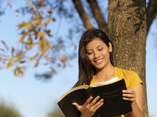 happy woman reading the word of God
