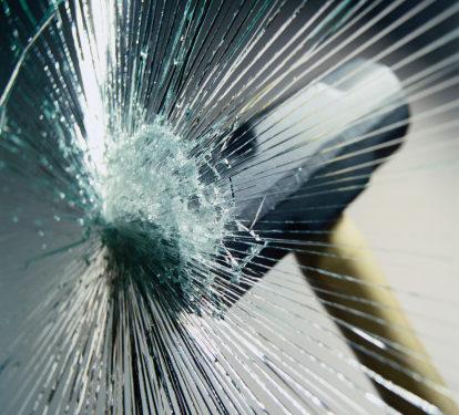 sledgehammer hitting glass