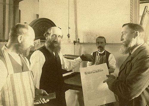 Publishing Uriah Smith, right, and other Adventist publishing leaders reenact in the 1890s the early days of the church's publishing ministry. [photos courtesy Office of Archives, Statistics and Research]