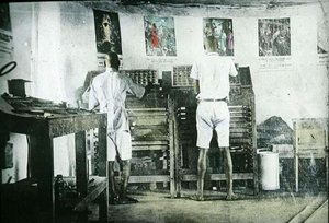 Two men working in a printing office