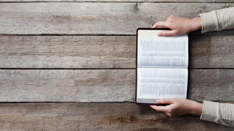 woman studying open bible to gain understanding from it