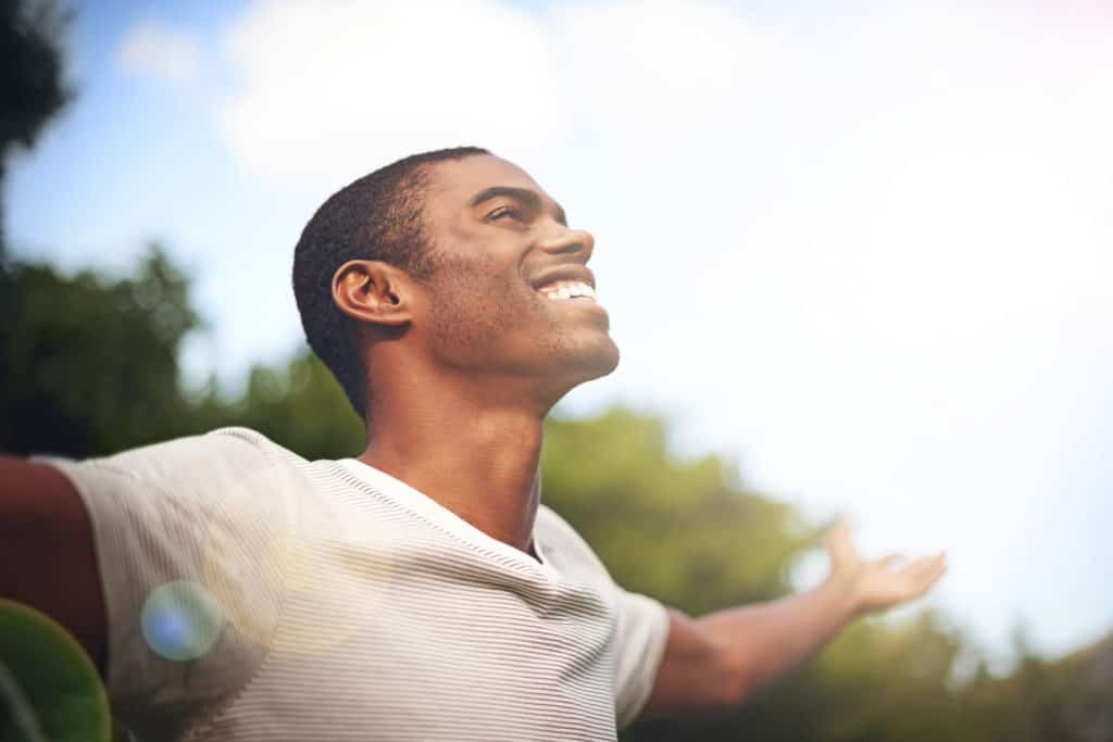 man with open arms happy to discover bible answers