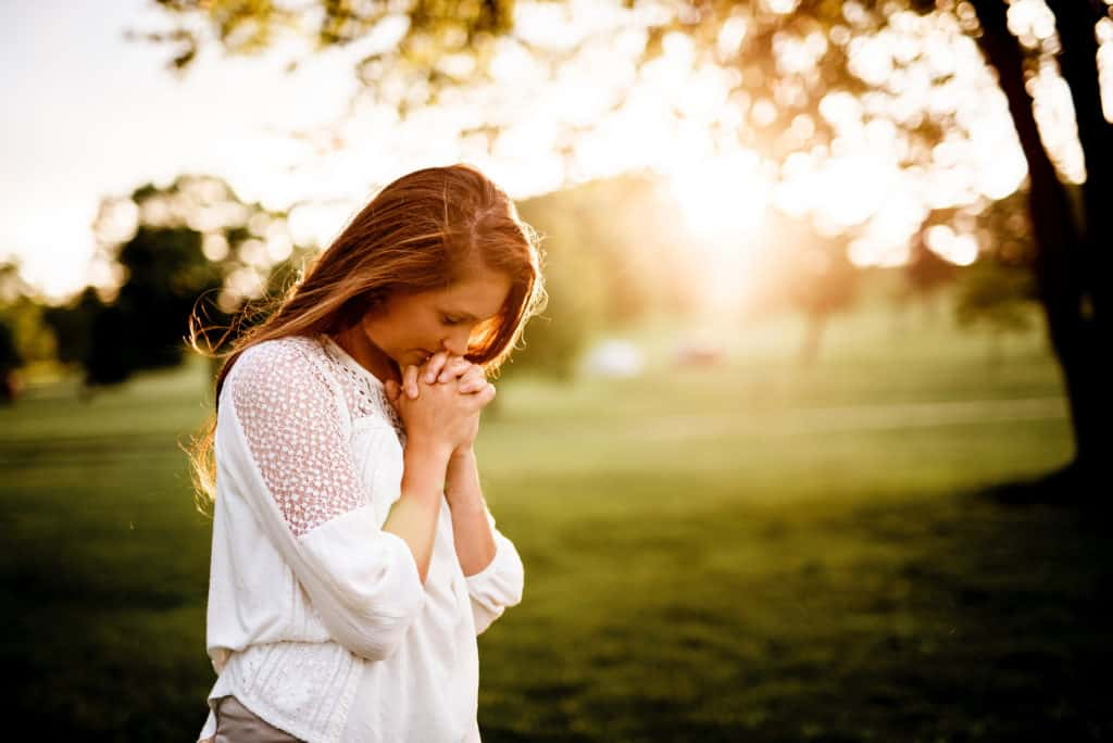 woman walking outdoors praying for wisdom to understand supposed bible contradictions