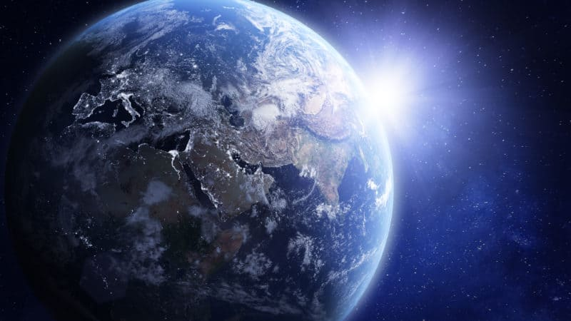 Outer Space photo of Sun shining from behind the earth