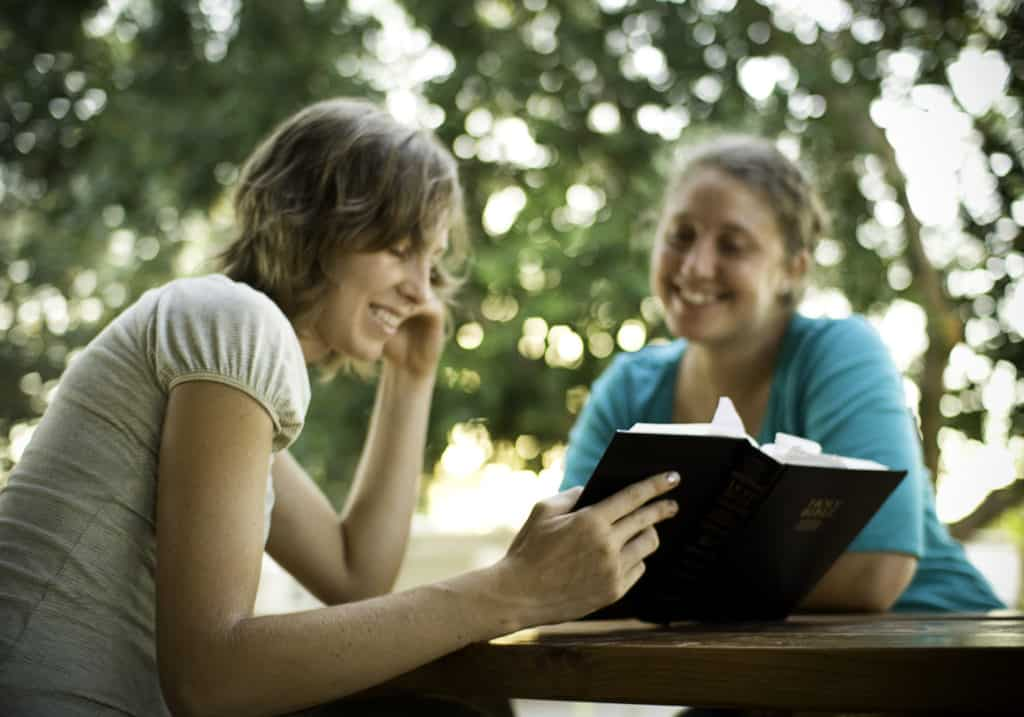 Two women reading Bible