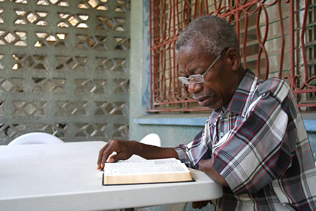 Elderly man with Bible