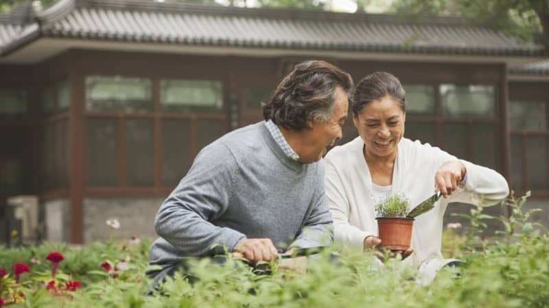 couple gardening together and enjoying a healthy lifestyle
