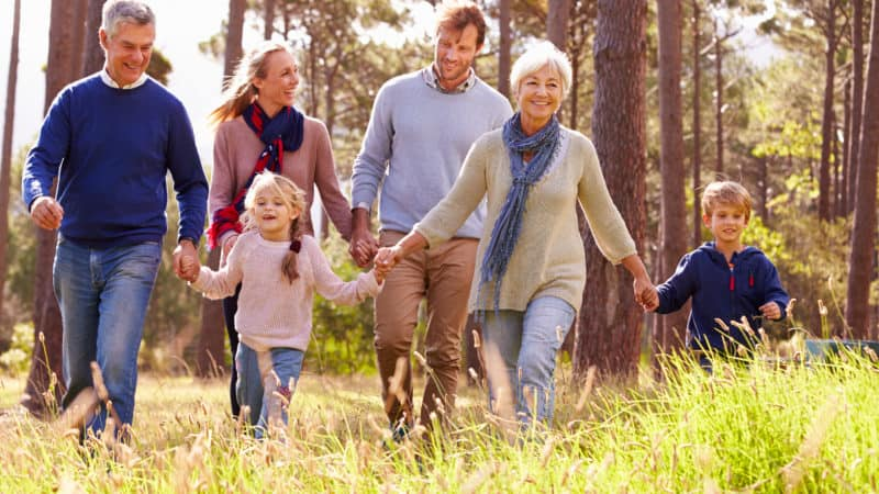 Multi-generational family on an outdoor walk