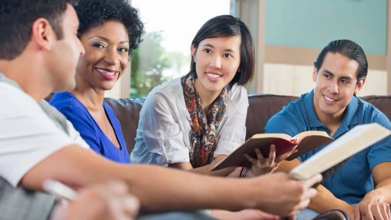 Young adults studying the Bible on Sabbath