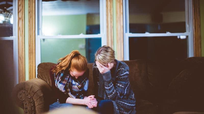 Two women praying