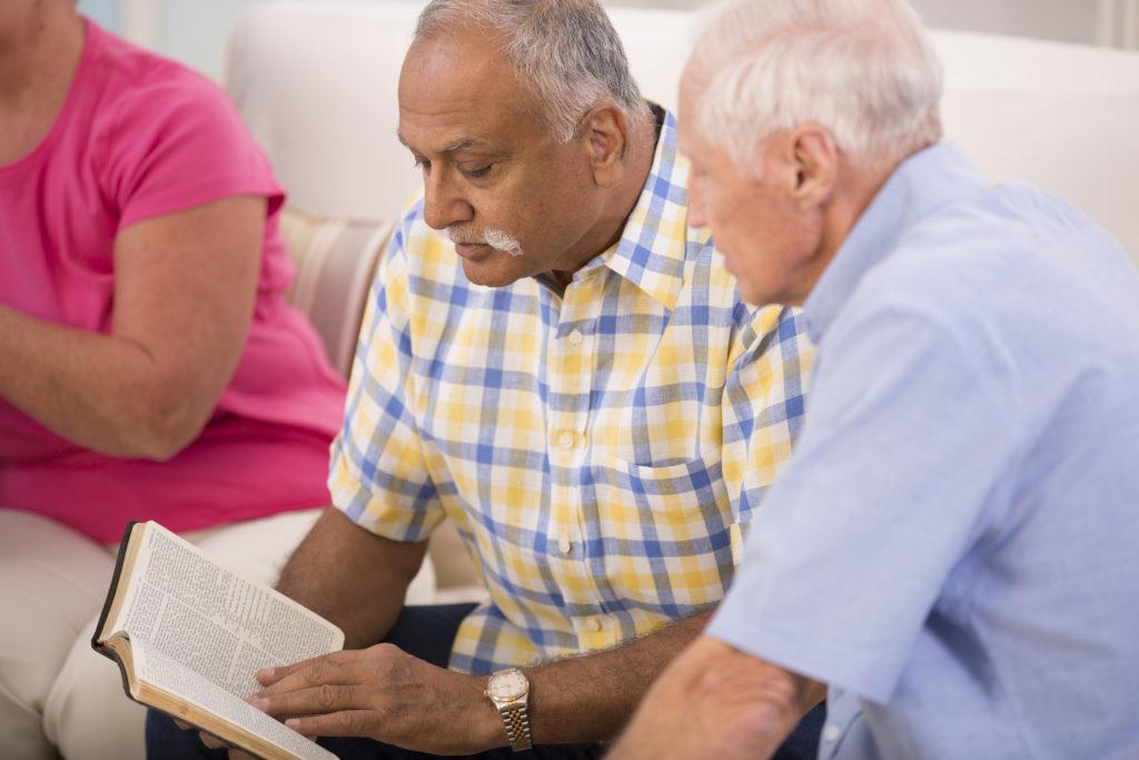 Senior men studying the Bible