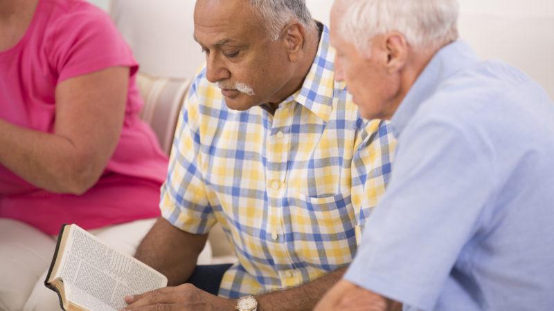 Men studying bible together
