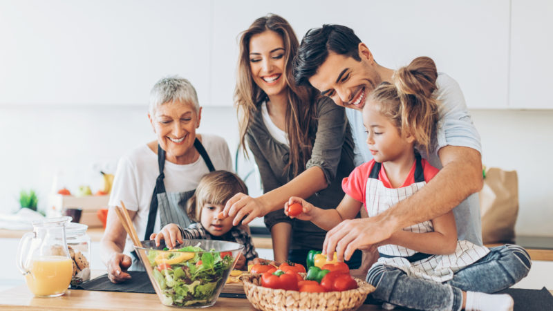 family having fun cooking together in the kitchen