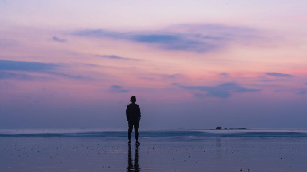 Man on beach after sunset