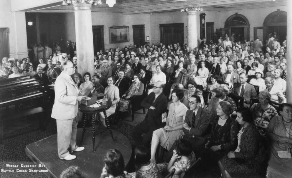 Famous Adventist John Harvey Kellogg answering questions at Battle Creek Sanitarium