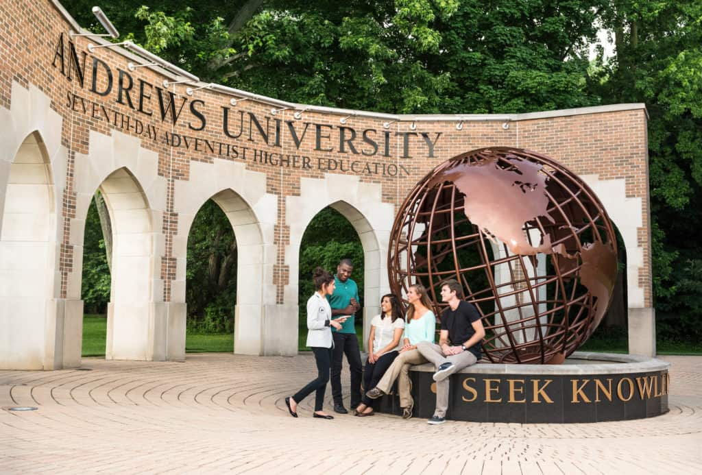 Iconic bronze globe statue and brick arches at Andrews University in Michigan