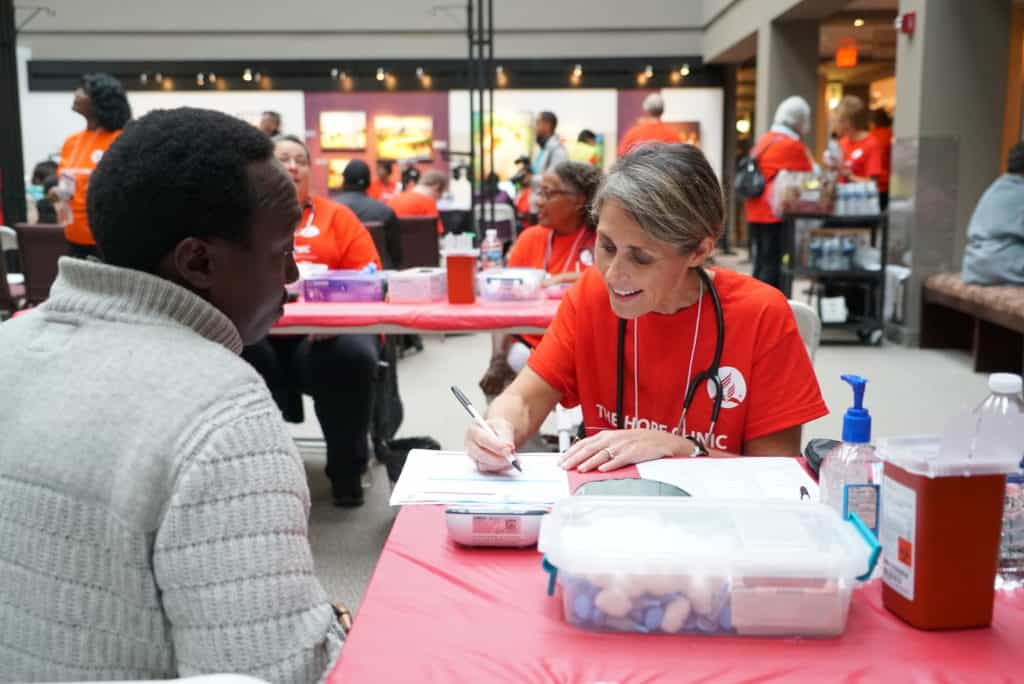 medical volunteer taking patient information at health clinic