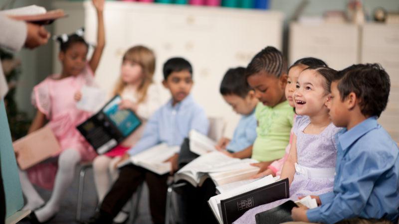 group of children sitting in a Sabbath school class