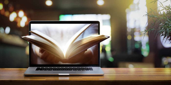 Open bible on a laptop screen used to study and prove that God and the bible can be trusted