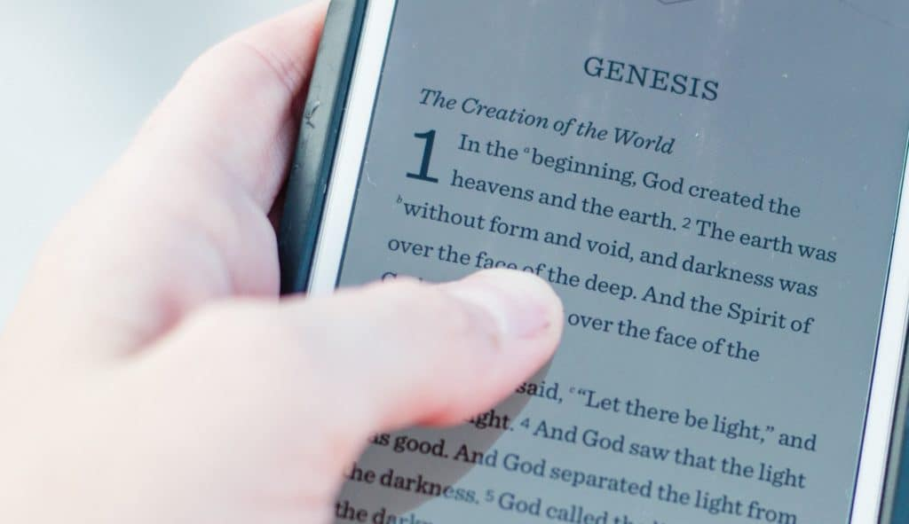 Biblical book of Genesis open on smartphone
