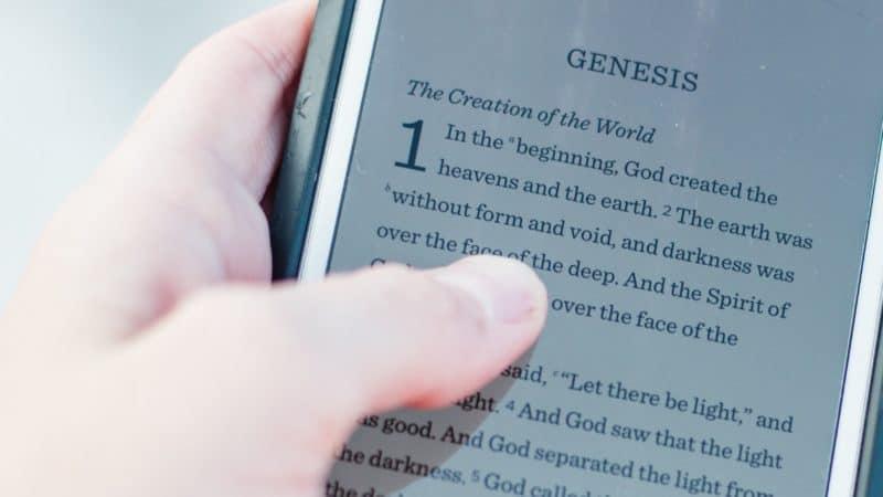 Biblical book of Genesis open on smartphone