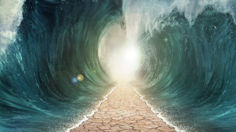 The seas are being parted with a pathway through the ocean.