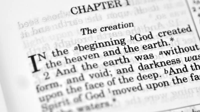 Bible open to Genesis chapter 1