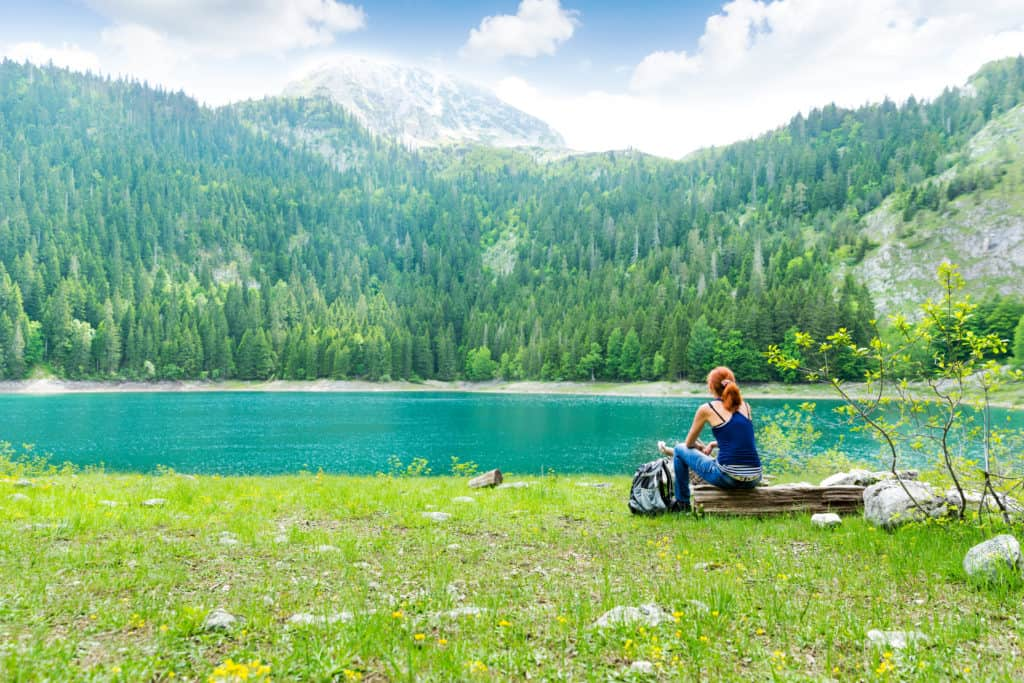 Traveler is resting at the lake, Durmitor National Park, Montenegro