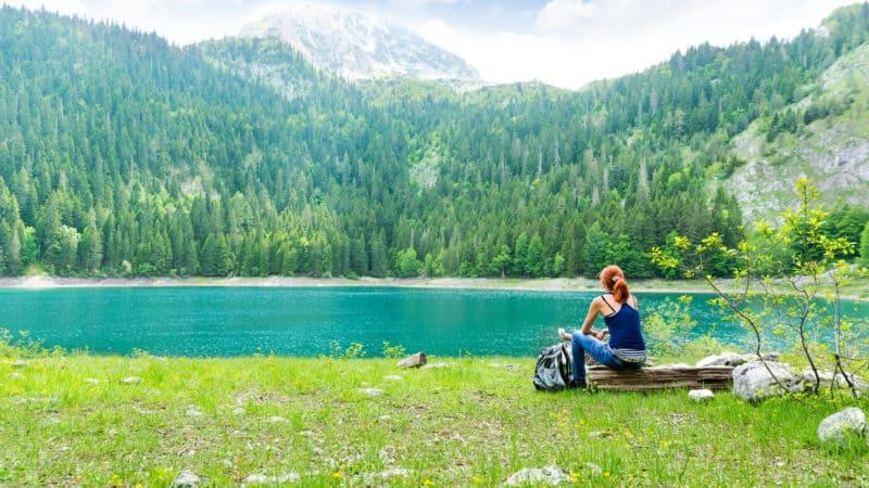 Woman enjoying the Sabbath by the lake at Durmitor National Park, Montenegro