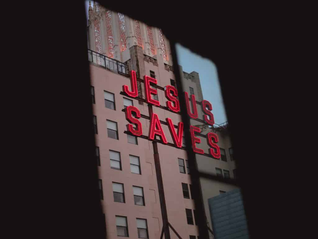 A sign on a building that says 'Jesus Saves'
