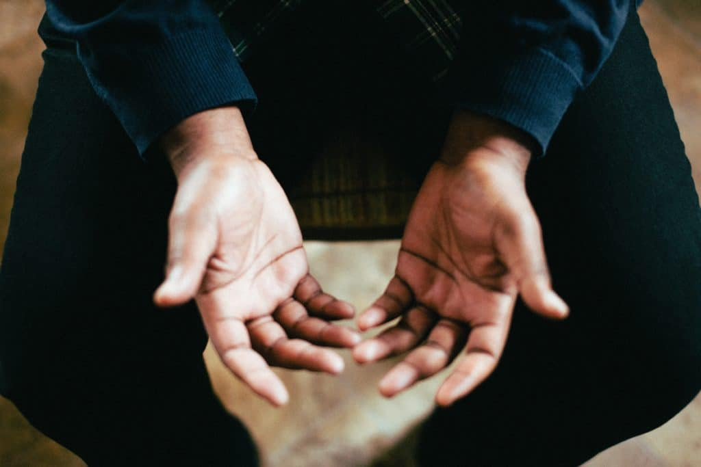 Close up of open hands with palms up.