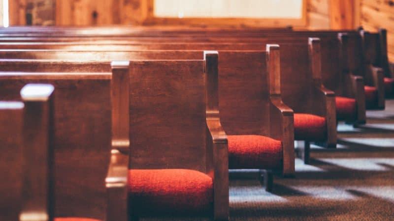 Empty church pews.
