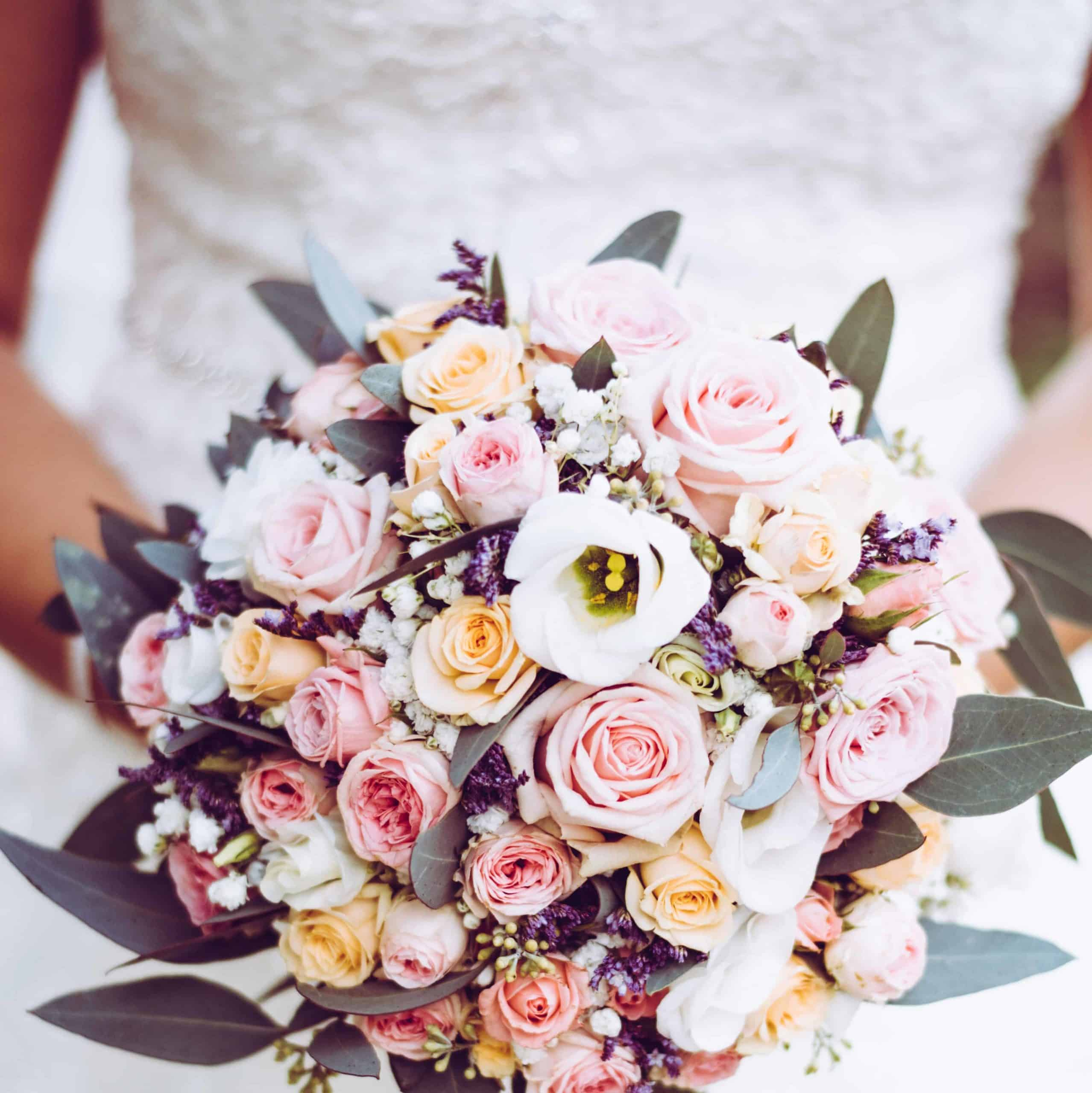 A bride holding her bouquet.