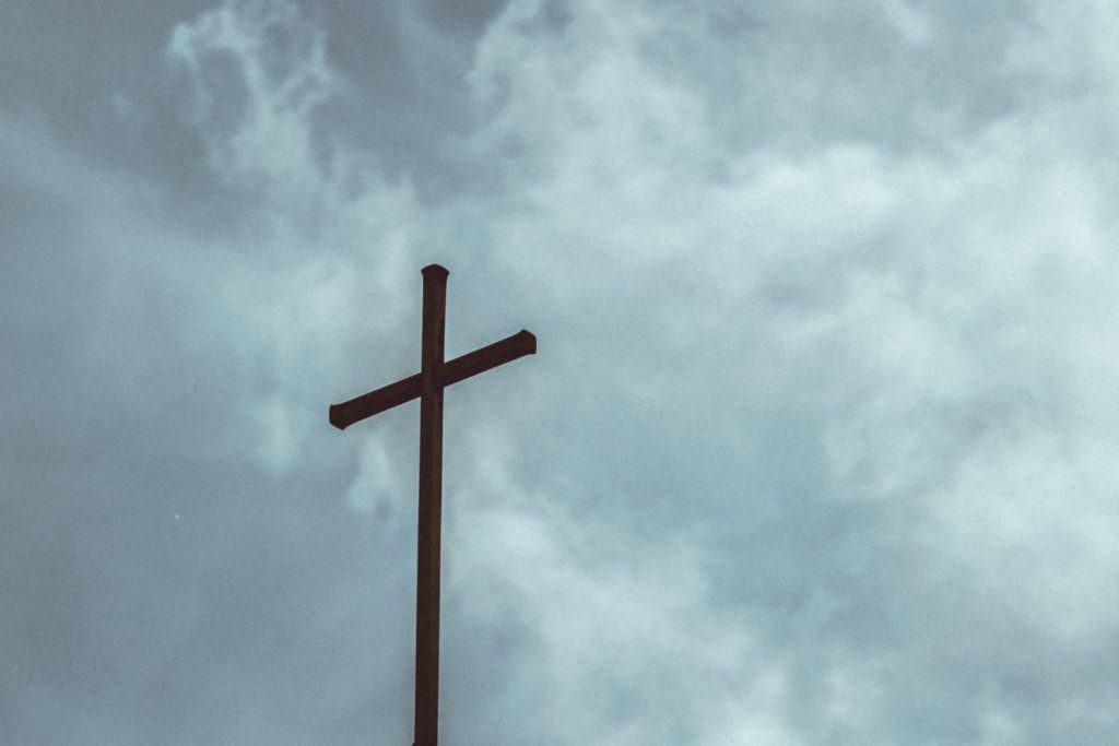 The cross against a cloudy sky.