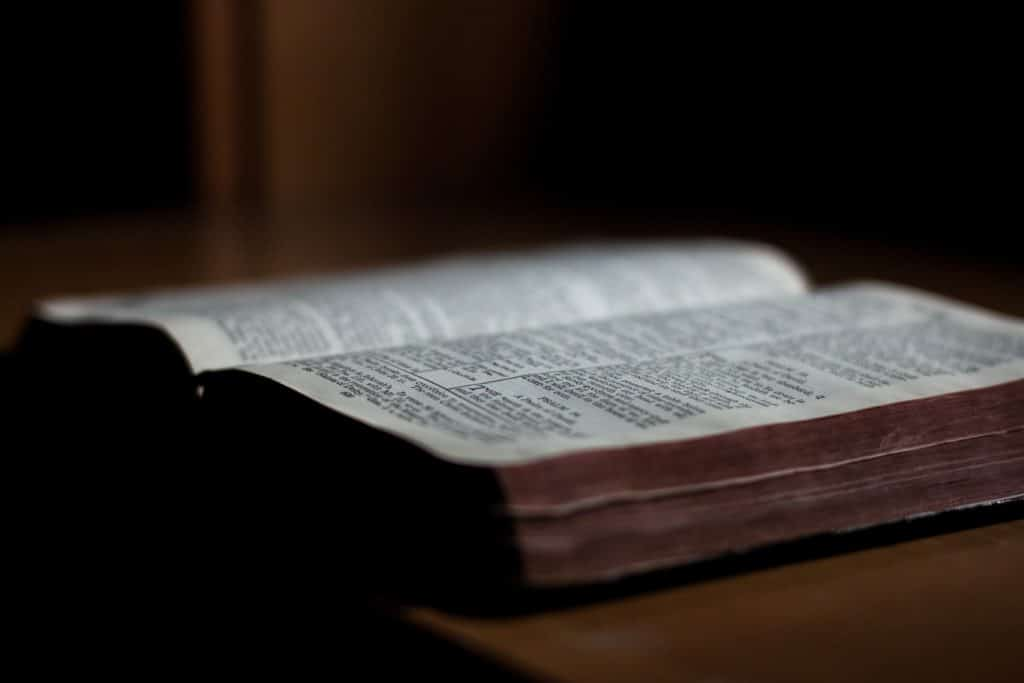 Close-up of an open Bible on a table.