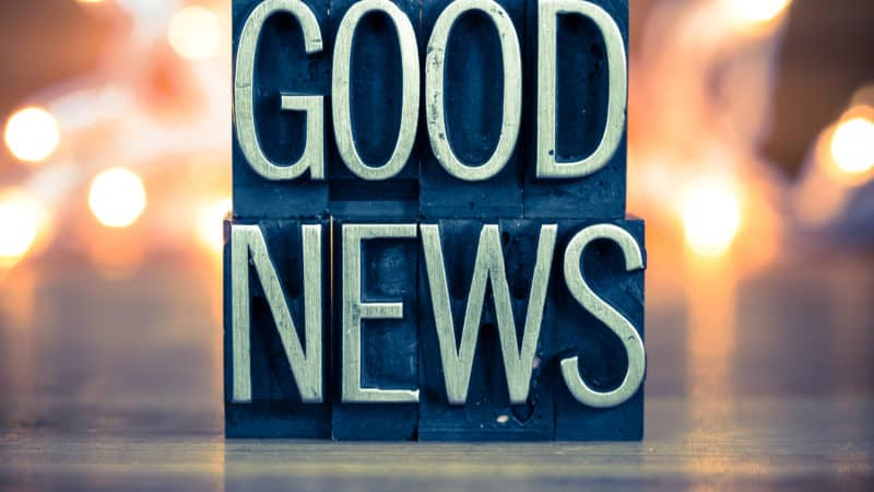 The words GOOD NEWS written in vintage metal letterpress type on a soft backlit background, reminding us of the Gospel