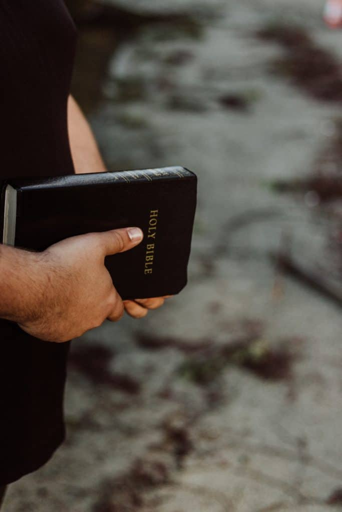 Close-up of a mans hands holding the Bible.