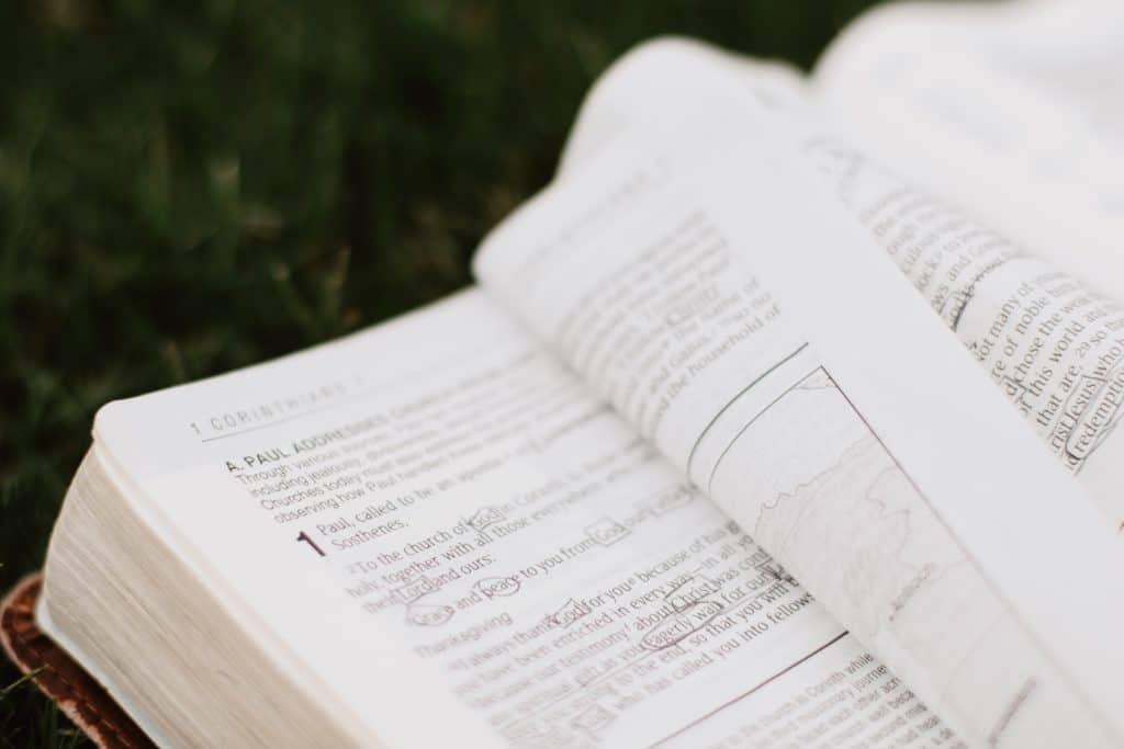 The Bible open to 1 Corinthians.