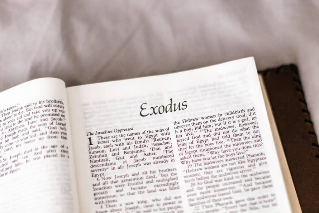 The Bible open to the book of Exodus.