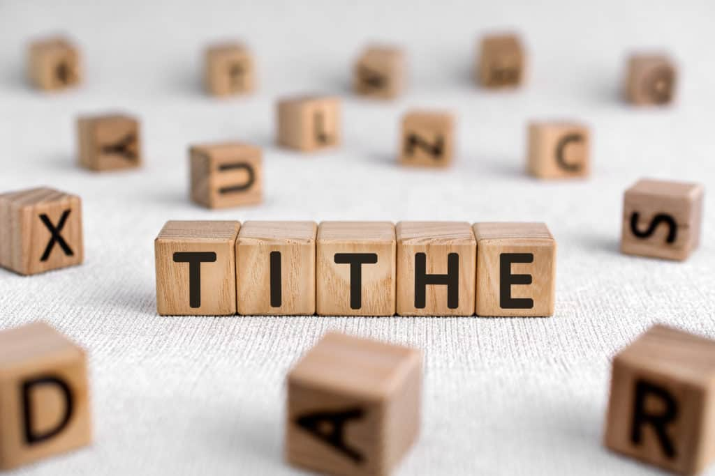 The word 'tithe' spelled out with block letters.
