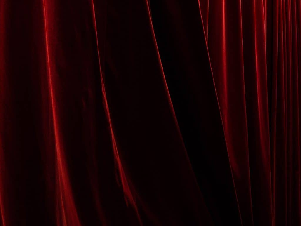 A close-up of a thick red curtain.