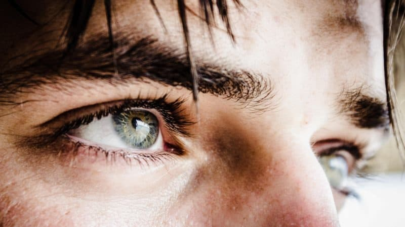 Close-up of a man's eyes as the Scripture says that every eye will see Him coming on clouds of heaven