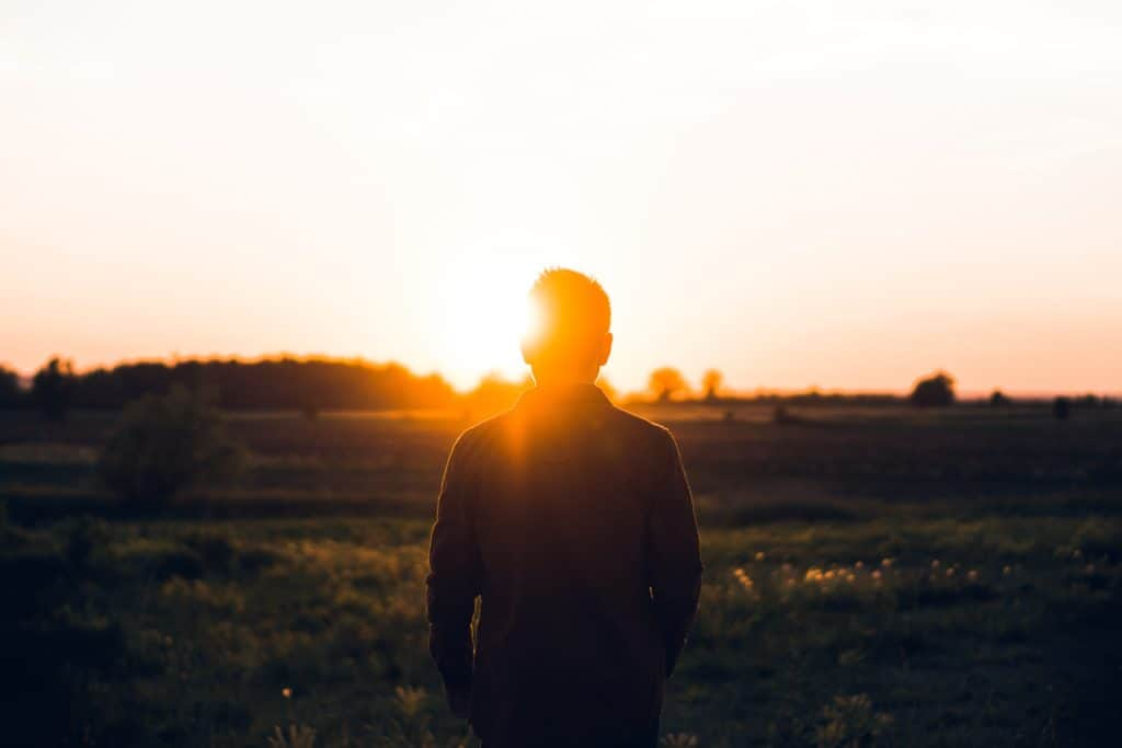 A man looking at the sunset.