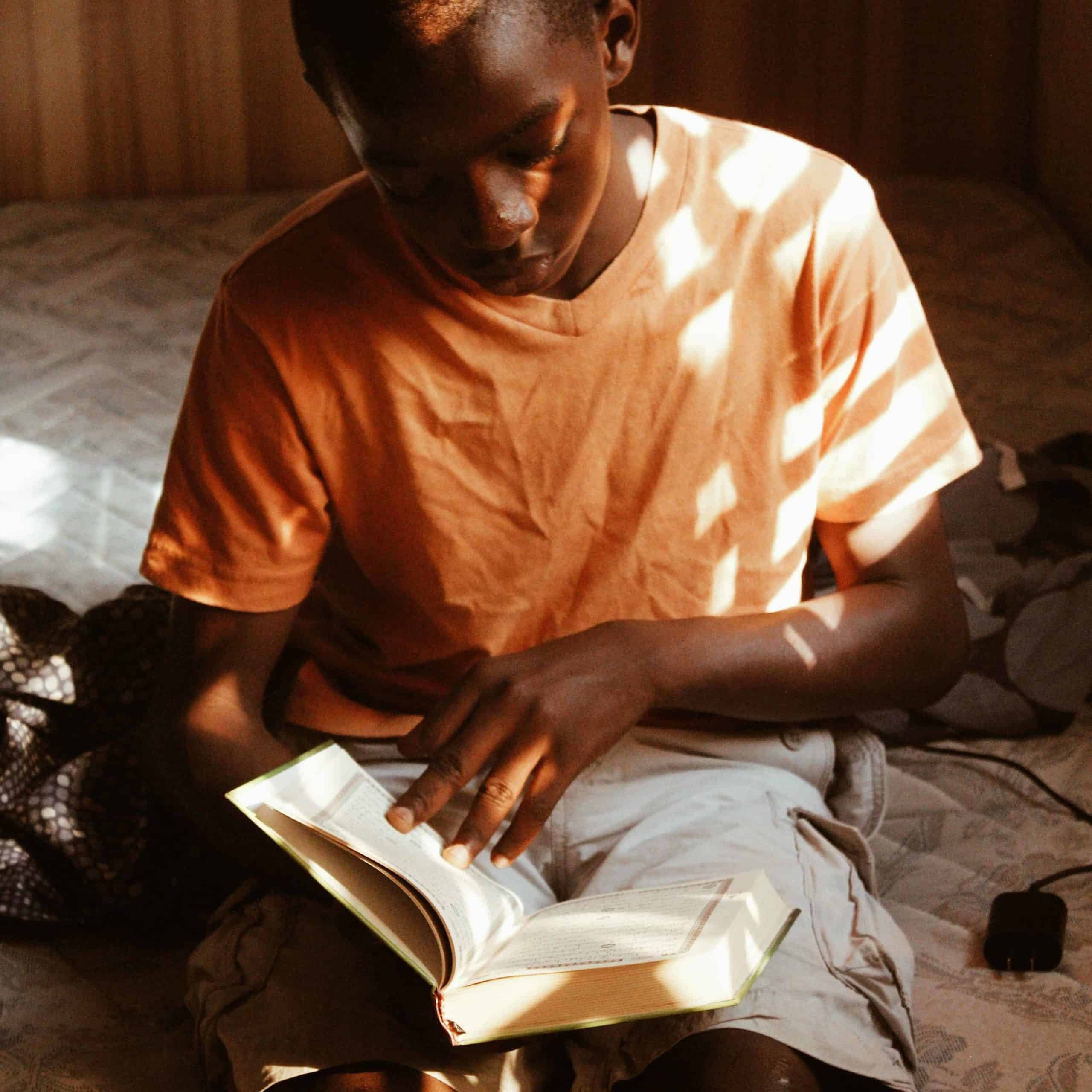 Boy studying the Bible.